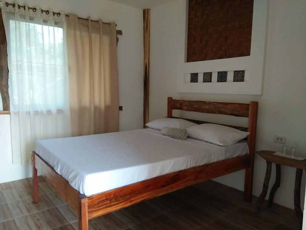 single bed in the best hostel in Siquijor - Sand 1 Hostel